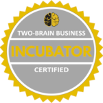 "A circular grey badge with the words ""Two-Brain Business Incubator Certified."""
